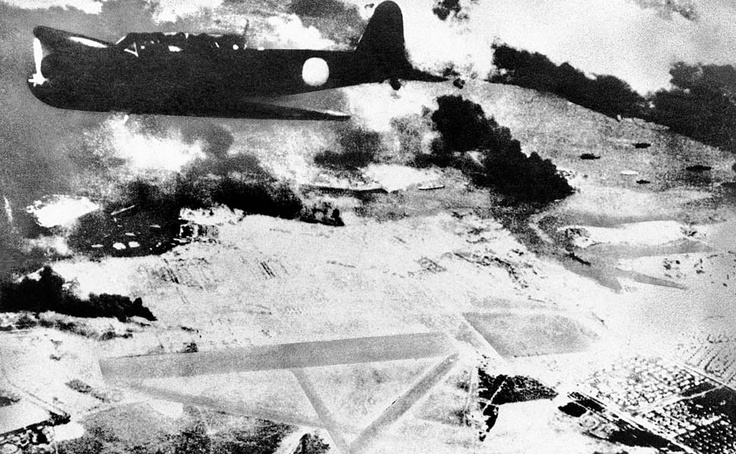 1941: A Japanese bomber on a run over Pearl Harbor.