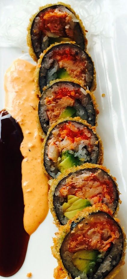 This is our special new Hotel California Roll! It is a crispy California sushi roll comprised of lobster meat, avocado and nori deep fried and seasoned with eel sauce and spicy mayo.
