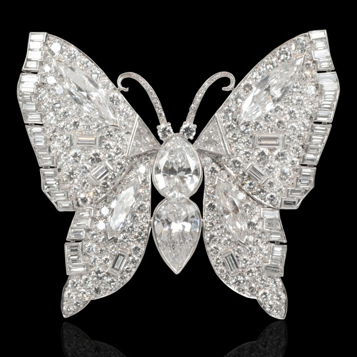 Magnificent diamond-set brooch designed as a stylised butterfly centering on two large pear shape diamonds of 3.01ct and 2.64cts and wings set through-out with brilliant, baguette, marquise and triangular step-cut diamonds American circa 1950