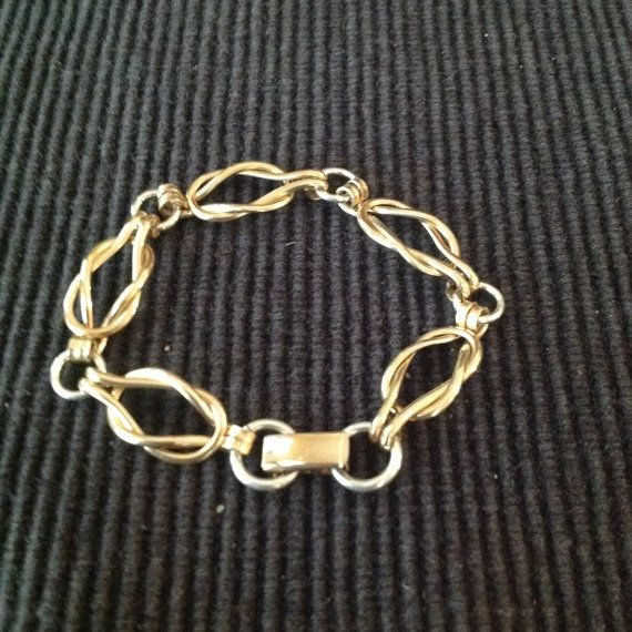 The bracelet style is called the Sailors Knot or Love Knot. This listing is for the heavier weight version, made with 12 gauge sterling silver wire for the knots and 14 gauge for the round connecting links. This bracelet will have a handmade Toggle clasp which may differ slightly from the one pictured. Can be ordered with an optional foldover clasp (shown center) or a high quality swivel clasp I The first 2 photos are of the heavier weight bracelet in this listing. The last 2 are the lighter…
