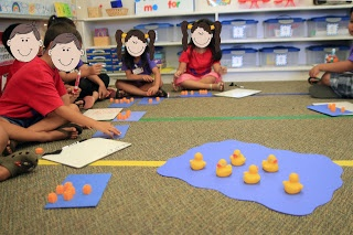 """We read Five Little Ducks and acted out subtraction problems using duck puppets. Then we used rubber ducks in a """"pond"""" to model subtraction stories. I modeled with the ducks while the kids used orange cubes for ducks and blue construction paper ponds."""