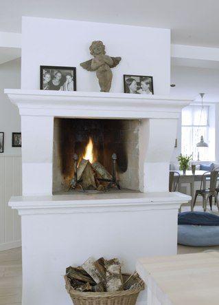 Unusually high fireplace. From a Swedish home. Love the cherub. Scandinavian  ...