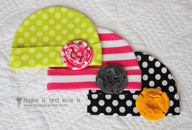 DIY Baby Hats with Flowers. Once the infant outgrows, you could probably cut and alter to make into headbands. http://www.makeit-loveit.com/2011/02/knit-receiving-blanketknit-baby-hats_08.html