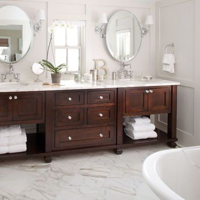 Traditional bathroom with rich dark wood cabinets and a feminine twist #design #interiordesign