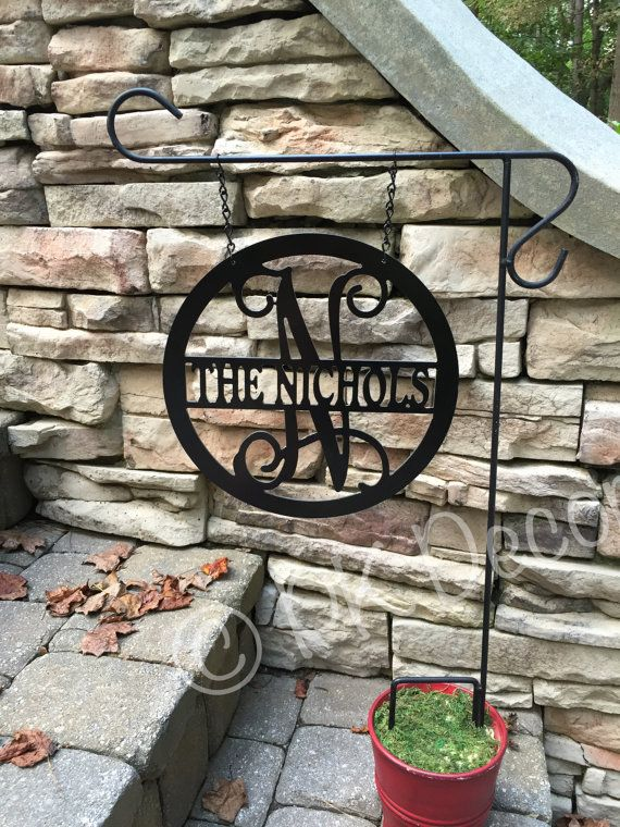 12 Metal Yard Décor personalized with your initial w/ last name in the middle. Comes in a variety of colors: white, black, silver, blue, red, green and $25 - Bought this one