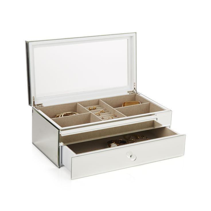 Art Deco'nun o ihtişamlı tarzını hatırlatan bu aynalı mücevher kutusu, şeffaf camdan bir kapağa ve doğal keten kaplı iç bölmelere sahip.