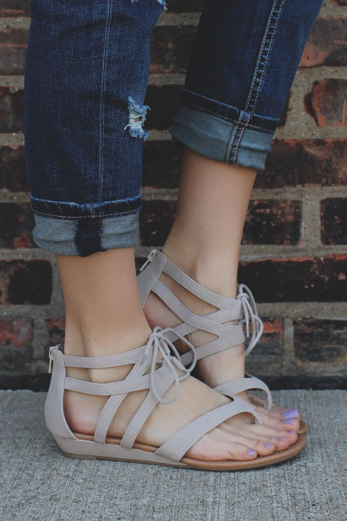 Mini wedge, gladiator sandals with a lace up ankle cuff and a zipper back.