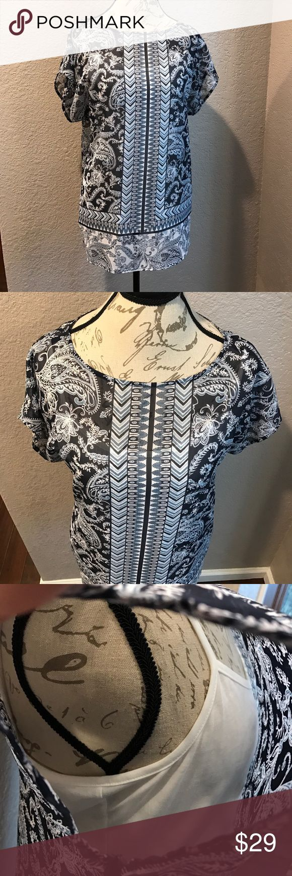 Liz Claiborne New without tags unworn. Sheer tunic over white Cami. Blue and white tones. So much more beautiful than on this manikin. Due to the size being a large, it looks different on a size small manikin in a person Liz Claiborne Tops