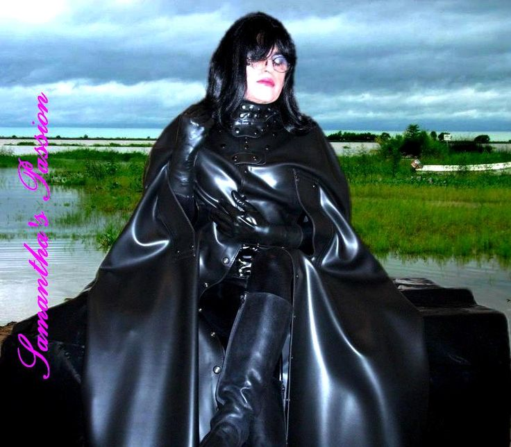 Enjoying to wear a heavy rubber cape.