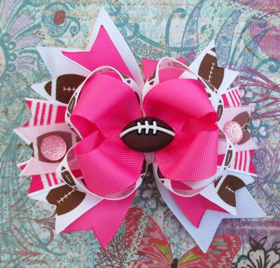 Hey, I found this really awesome Etsy listing at http://www.etsy.com/listing/152778324/football-hair-bow-pink-girls-summer-fun