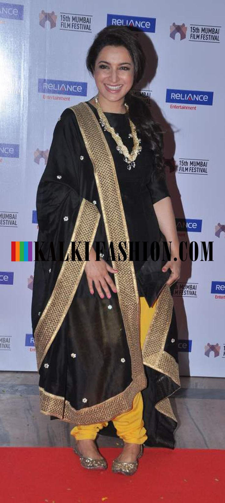 http://www.kalkifashion.com/ Tisca Chopra in a black and yellow suit by Payal Singhal at 15th Mumbai Film festival closing ceremony.