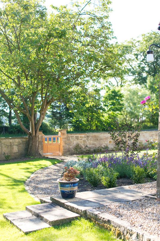Spring view of the front garden, now a tranquil easy-care space. Photo By Natasha Cadman
