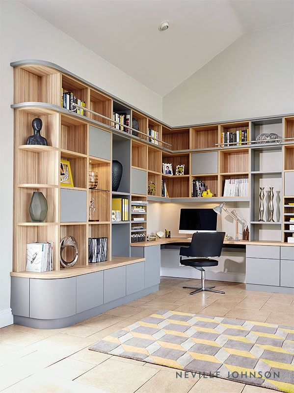 This grey study has been designed to fit perfectly with the flow of the room using curved edges. Offering a range of storage options; both for functional and decorative purposes, this contemporary office furniture adds an aesthetically pleasing backdrop to this spacious and airy room, while also acting as an impressive modern library.