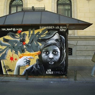 The street art and graffiti in Madrid are absolutely stunning! Does anyone know the artist of this piece that I noticed on a local kiosk or newsstand? Stay tuned for upcoming photos!