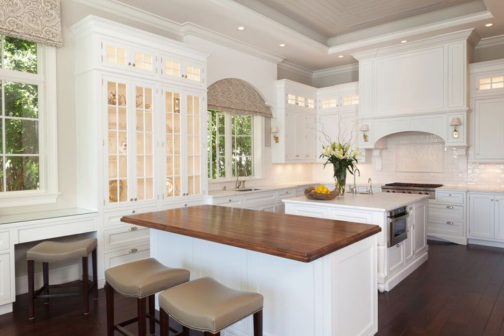 This kitchen is stunning don't you think?  The use of lighting underneath the overhead cabinetry, and even inside the glass fronted cupboards creates a gorgeous lit space.  Note the down lights overhead as well.  This is a great example of how multiple styles of lighting can be used together.