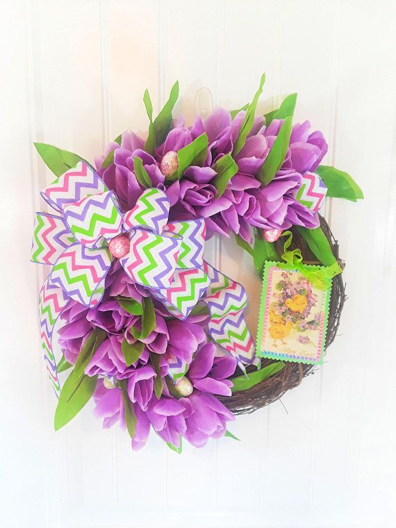 Easter Wreath with Lush Lavender Tulips and a Happy Easter sign which is detachable. Lavender is the color trending this year and will make a huge statement whether you use it as a small wreath for window or a small wreath for door. The wreath is made using a 14 grapevine wreath form.
