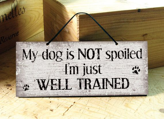 Wall sign in brown with the funny saying:  My dog is NOT spoiled. Im just WELL TRAINED.  This simple but elegant sign is a mixture of modern,