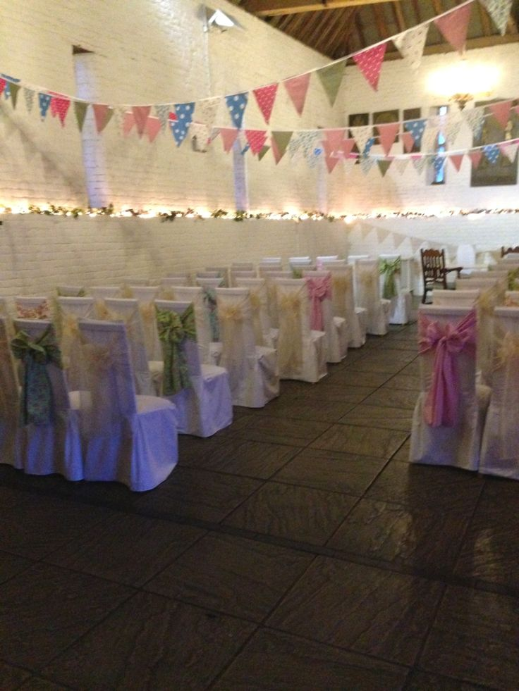 White Cotton Chair Covers with Ivory and floral Sashes at Ufton Court