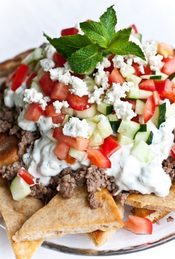 Greek Nachos - tomato, cucumber, ground beef, mint and some tzatziki Great snack with less fat (watch ingredients - fat free yogurt and very low fat ground beef-snack this can be a meal! Add lots of tomatoes and cucumbers.) Use whole grain/wheat pitas too.