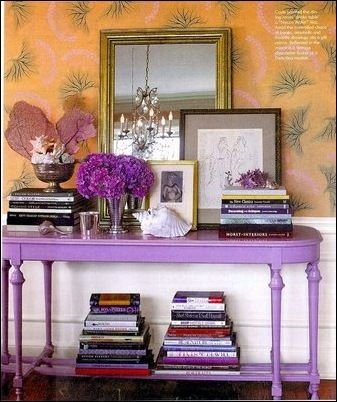 Love this table and wallpaper combination!  Purple table and palm wallpaper + books and frames and things.