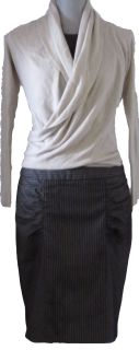 This wrap sweater offers diversity and comfort. Can be wrap around torso to accentuate the waist or left to drape the body.
