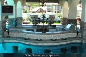 Oh my goodness. That is one fancy outdoor kitchen and pool bar.