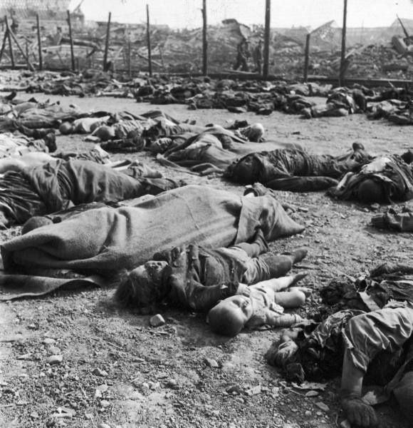Bodies of men women and children killed at the Nordhausen concentration camp. Location: Nordhausen, Germany Date taken:	April 1945