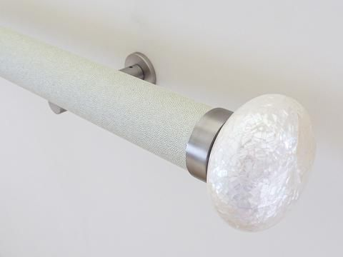 50mm diameter wrapped and tracked white pepper curtain pole with riva ellipse finials, steel brackets