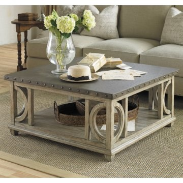 Coffee table. Textured, soft taupe-gray driftwood finish.
