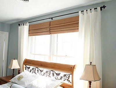 You don't have to spend big $ on custom blinds for a large window.  Two standard-sized blinds hung together look great.