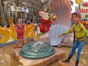 Manhole cover cut by hand to show the sheild of the town Xàtiva, in the falla JLC de Xàtiva, 2007