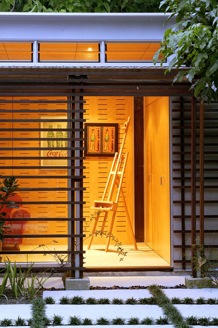 Graceville Studio: Paved entry with timber screening. See more at http://blighgraham.com.au/projects/graceville-house