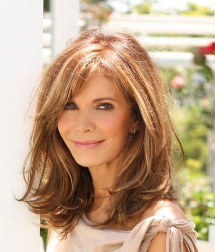 Love the brown on brown highlighted color and the lightly layered cut with long side swept bangs.