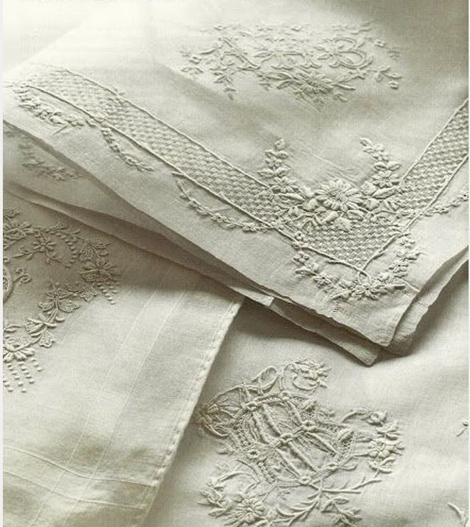 Embroidered monogrammed linen serviettes.