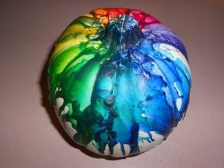Melted Crayon Pumpkin i know @Shannon Kenkelen will be making one of these bad boys!