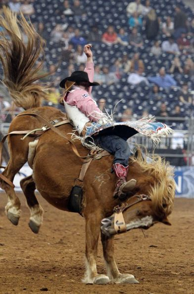 Kaycee Feild competes in Bareback Riding during the BP Super Series III Round 2 at Reliant Stadium on Monday, March 4, 2013, in Houston.    Photo By Mayra Beltran/Houston Chronicle