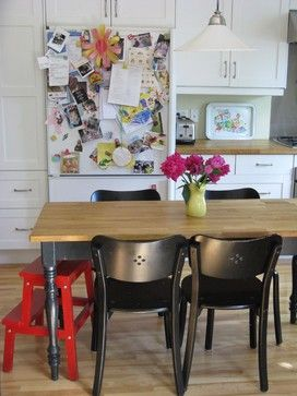 The Helping stool. No kitchen with kids should be without a helping stool — make sure yours is tall enough to let your smallest child reach the sink for hand washing. Keep at least one section of counter cleared of potentially dangerous items (like the knife block) and make that your child's special helping spot. A basket of kid-size cooking tools and an apron would make a nice addition.