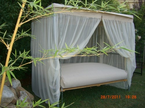 outdoor swinging bed...this would be such a great place to spend a summer afternoon