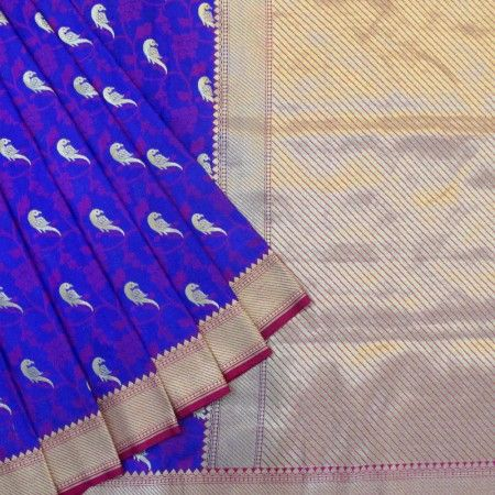 Stunning blue coloured banarasi saree with gold zari parrot motif sitting on pink bel all over the base.The border of the saree has narrow pink and diagonal lines in gold zari.