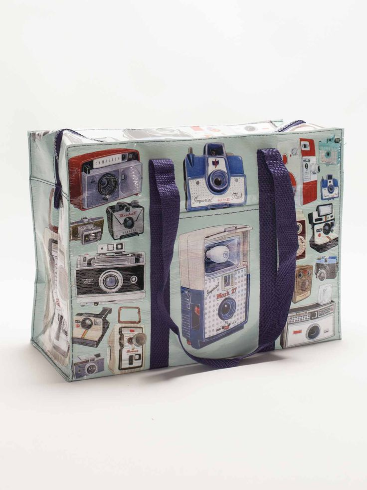 Portraits from a time when film was king. By Christine Berrie. Made with 95% post consumer recycled material, a roomy exterior pocket, and shoulder length straps.