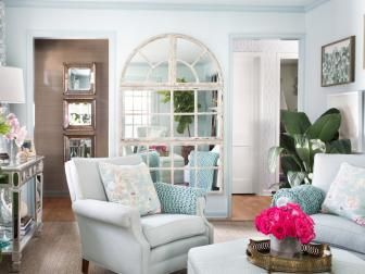 Designer Brian Patrick Flynn Gives This Small Living Room An Open Look And Feel With Pale Blue Wall Paint Furniture Drapes Throw Pillows