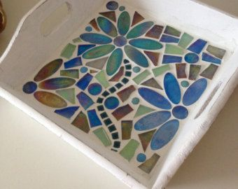 A nice tray in retrostyle. Made with glass mosaic and glass stones. Just for decoration or in order to use. Size is 9.84 x 9.84 inch or 25 x