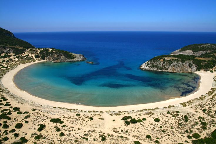 Voidokilia Beach is a popular beach in Messinia, in Southern Greece. The beach is in the shape of the Greek letter omega (Ω) and its sand forms a semicircular strip of dunes. The land facing side of the strip of dunes is the Gialova Lagoon (or Yalova Lagoon), an important bird habitat; and the whole area is part of a Natura 2000 protected area (Natura 2000 is an ecologice network of protected areas in the territory of the European Union. Photograph by Grzontan on Wikimedia Commons.