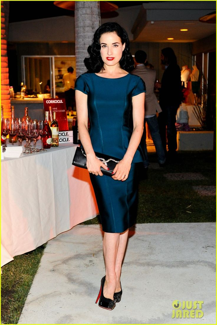 Dita Von Teese.  Herve L. Leroux dress.  Gosha Atelier for Bracher Emden purse.  Christian Louboutin shoes.