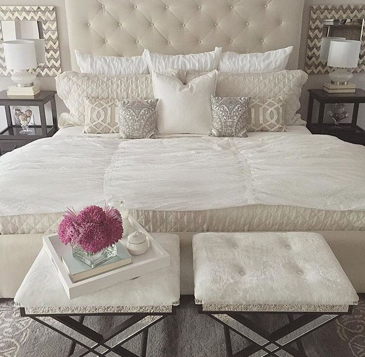 Soft white and cream bedroom. Love stools at foot of bed