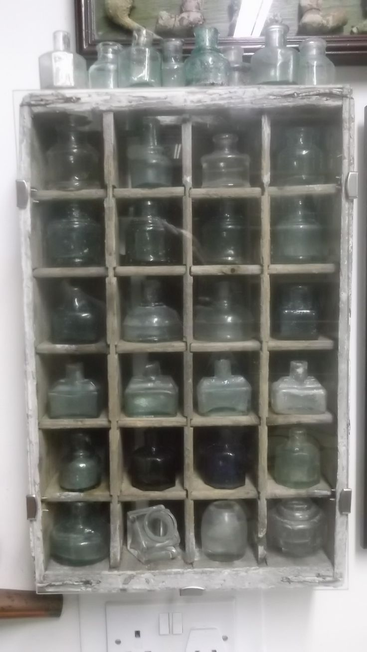 Box filled with glass ink wells .