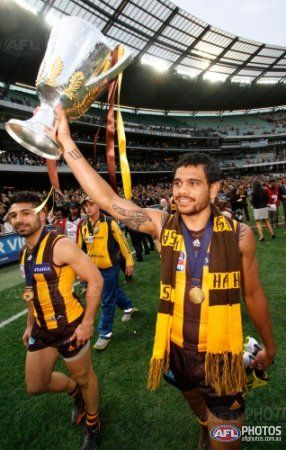 Hawthorn's Cyril Rioli holds aloft the 2013 Premiership Cup during the 2013 Toyota Grand Final match between the Hawthorn Hawks and the Fremantle Dockers at the MCG, Melbourne on September 28, 2013. (Photo: Greg Ford/AFL Media)