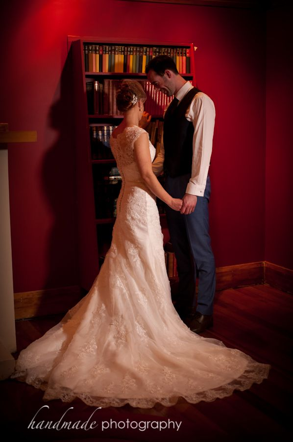 Bride and Groom in Red room (the Grange Room)