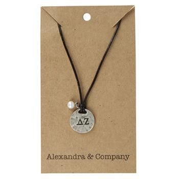 """Sisters Delta Zeta Necklace. Lovely stamped charm on brown leather cording. Zinc alloy charm has Greek Letters stamped on front with """"Sisters are Forever"""" stamped on back with a dainty bead that adds"""