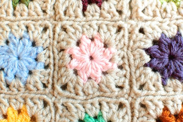 Check out this Cluster Burst Granny Square Pattern by Petals to Picots.  It's a great stashbuster project!